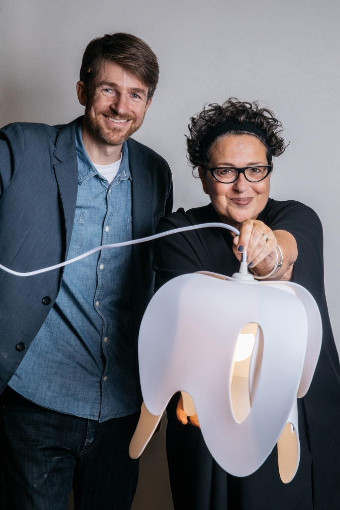 LightArt founder Ryan Smith and Editor-in-Chief of Interior Design magazine Cindy Allen pose with Cindy's Blossom pendent