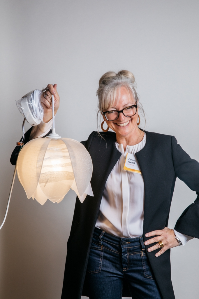Corinna Joehnk poses with her Blossom pendant