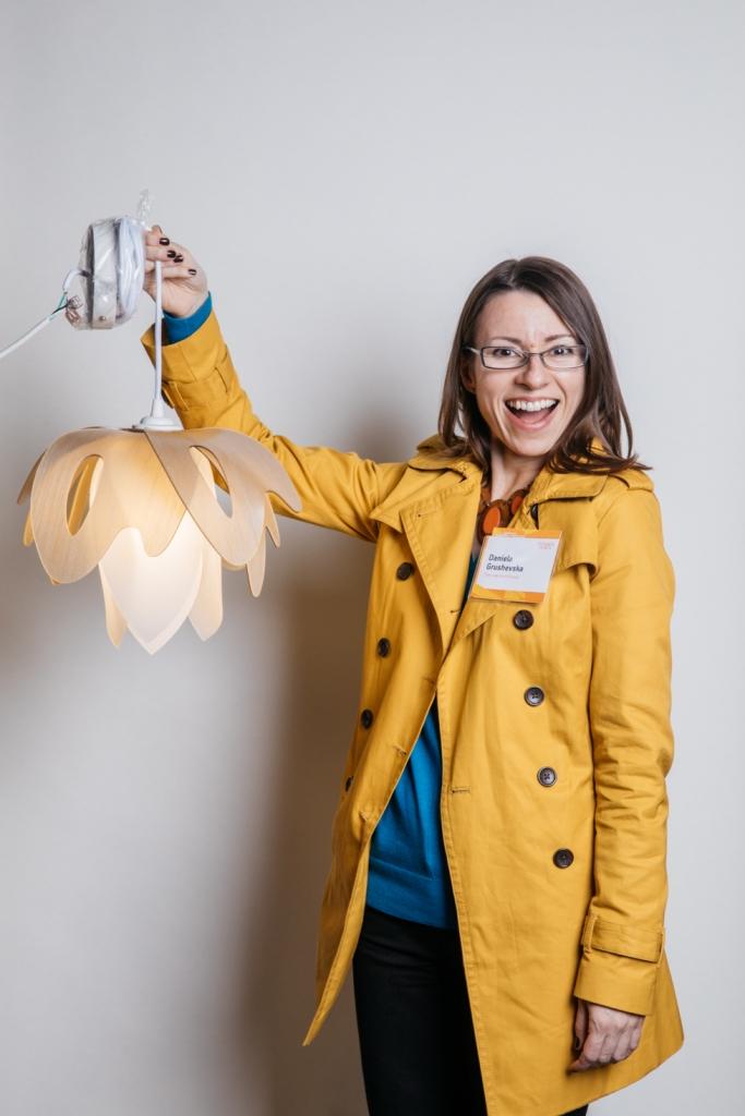 Daniela Grushevska poses with her Blossom pendant