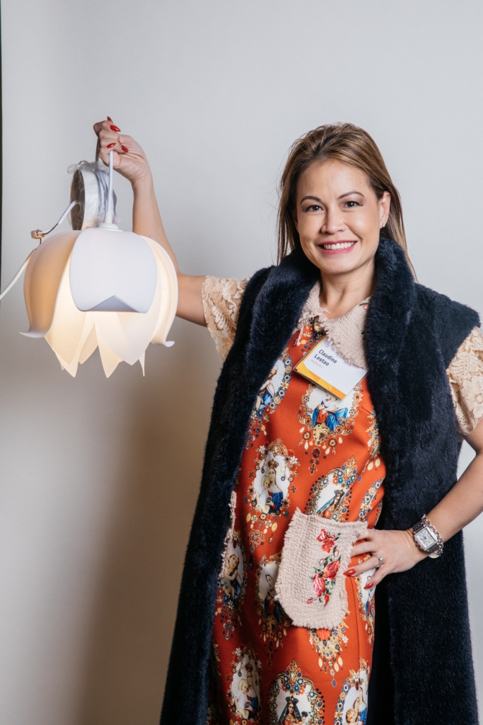 Claudine Lostao poses with her Blossom pendant