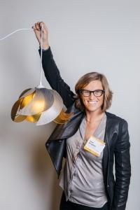 Sarah Broughton poses with custom pendant