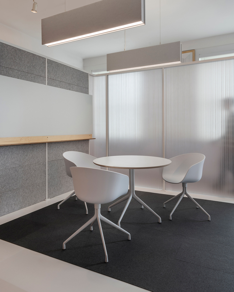 "Two 12""H Static beams compliment a meeting space within the show room"